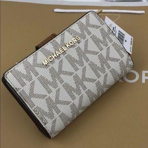 Michael Kors Signature PVC Vanilla Bifold Wallet